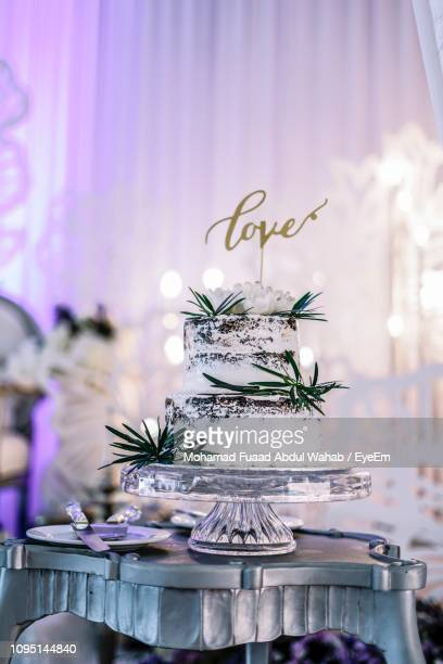 Close-Up Of Cake On Table In Party