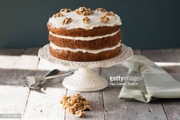close-up of cake on table - carrot cake stock pictures, royalty-free photos & images