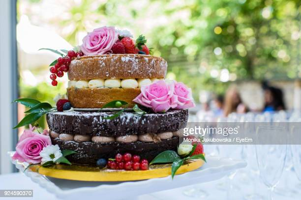 close-up of cake on table - wedding cake stock pictures, royalty-free photos & images