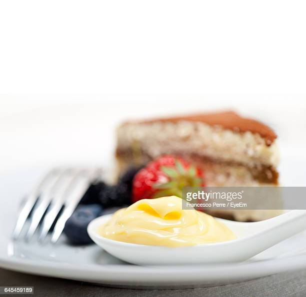 Close-Up Of Cake Served In Plate Against White Background