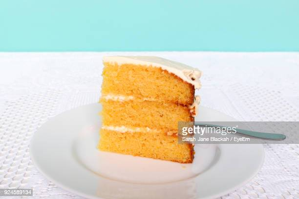 close-up of cake served in plate on table - weybridge stock photos and pictures