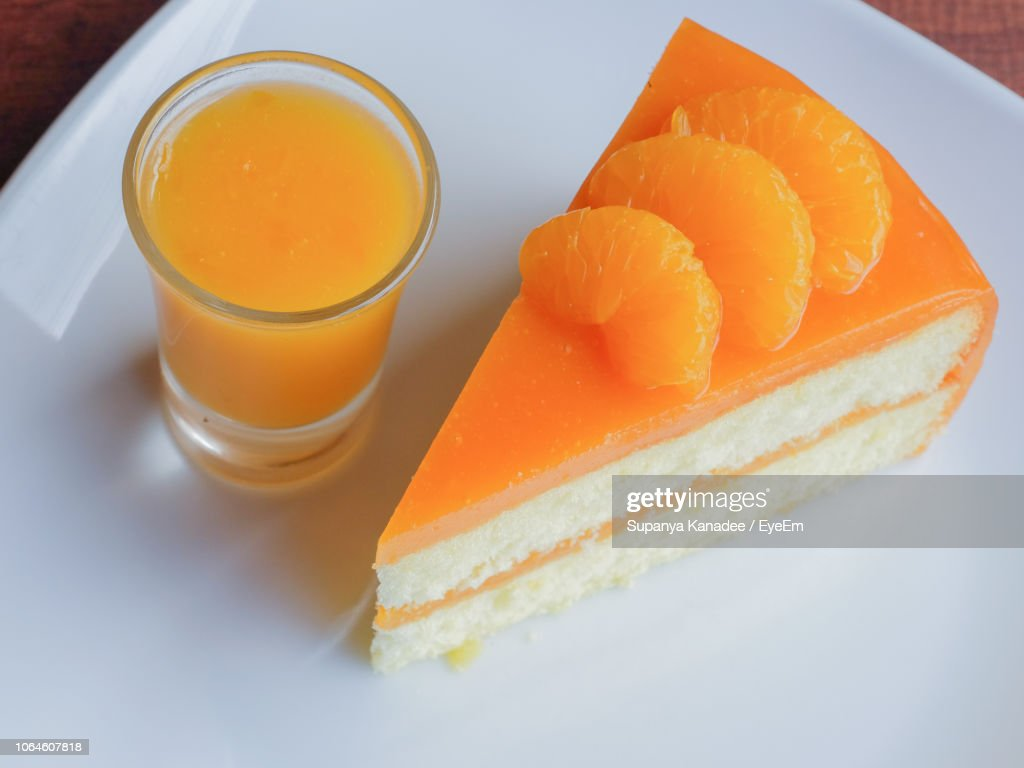 closeup of cake slice with orange juice on table picture id1064607818