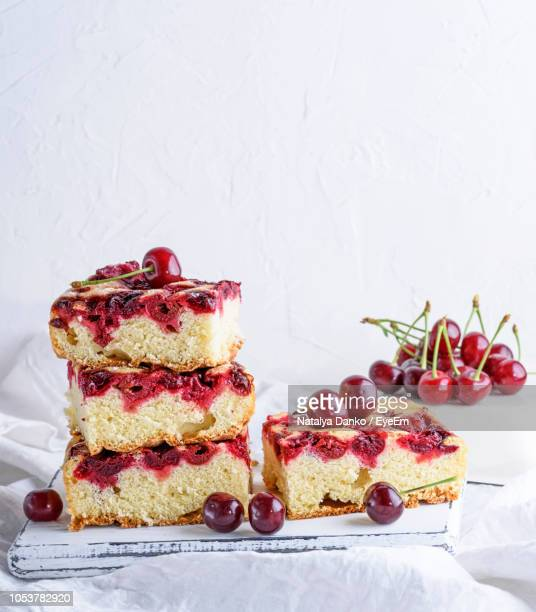 close-up of cake slices on table against wall - fruit cake stock pictures, royalty-free photos & images