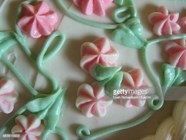 Close-Up Of Cake With Icing Flowers
