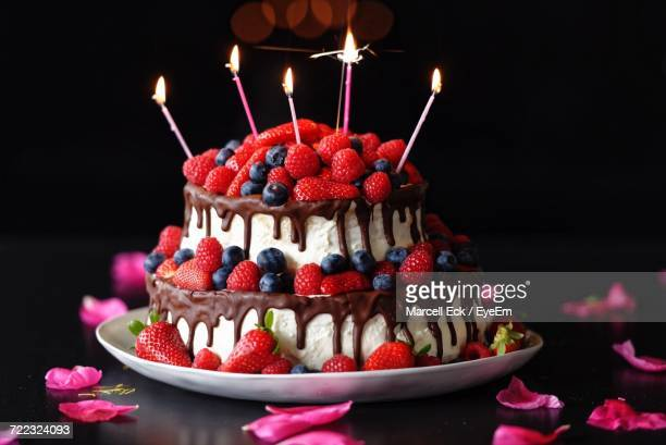 close-up of cake with strawberries - birthday cake stock photos and pictures