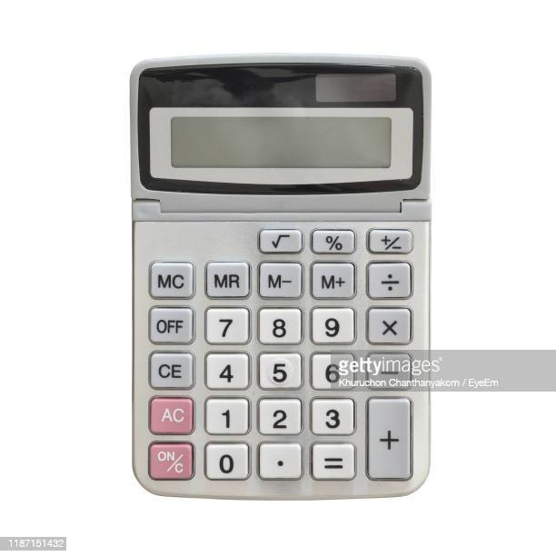 close-up of calculator against white background - calculator stock pictures, royalty-free photos & images