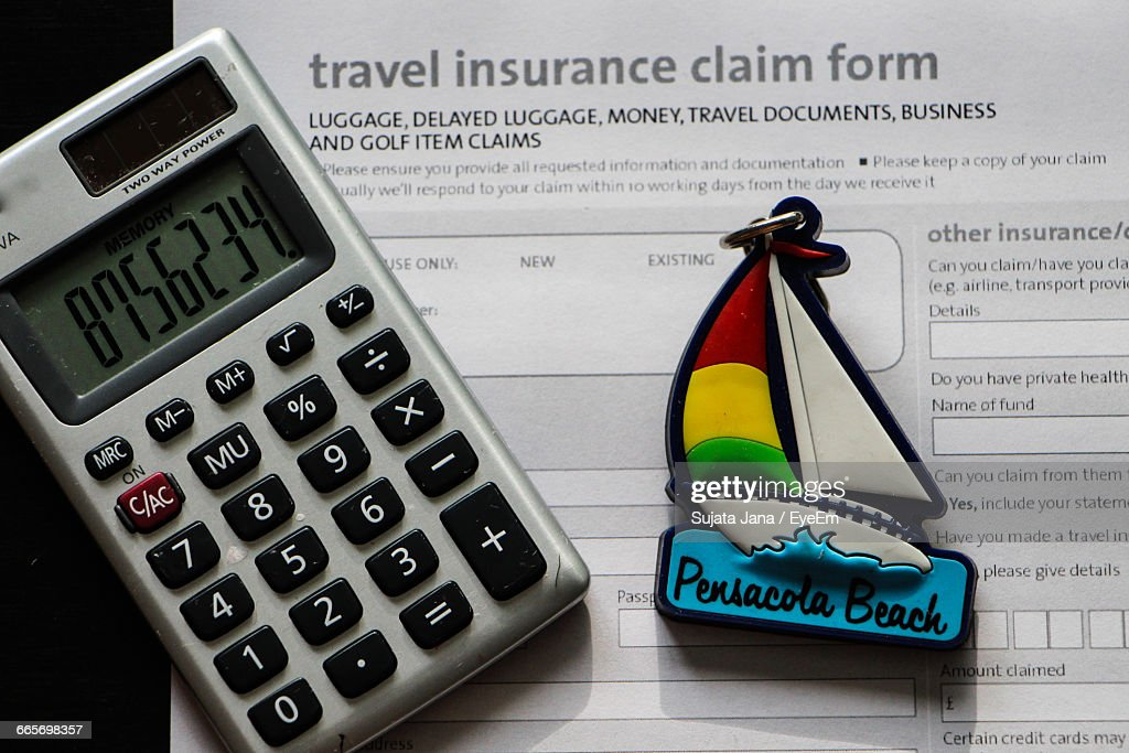 closeup of calculator and travel insurance form stock photo getty