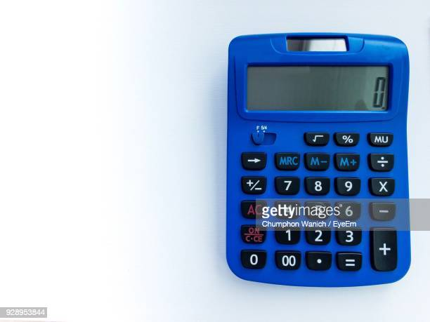 close-up of calculator on white background - calculator stock photos and pictures