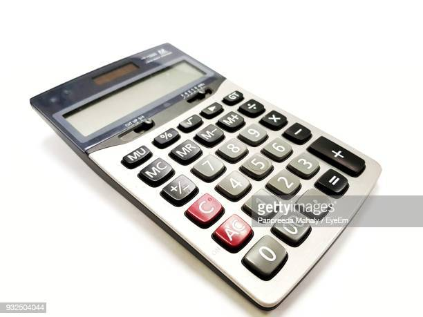 Close-Up Of Calculator Over White Background