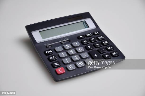 close-up of calculator over white background - calculator stock photos and pictures
