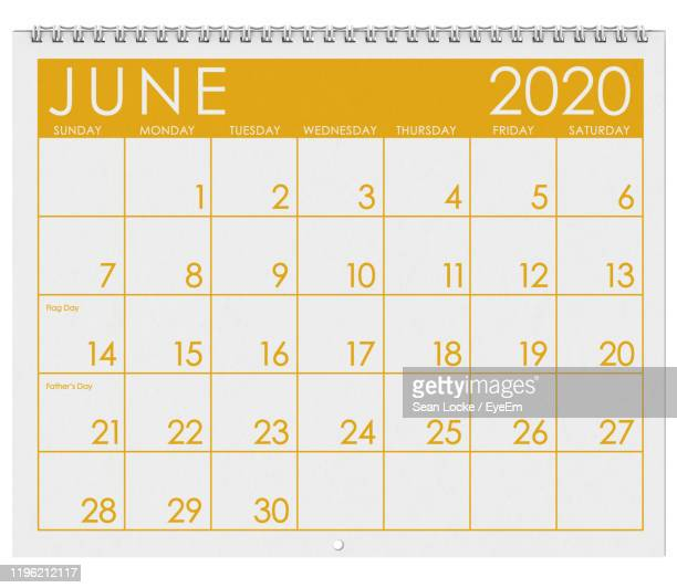 close-up of calendar against white background - june stock pictures, royalty-free photos & images