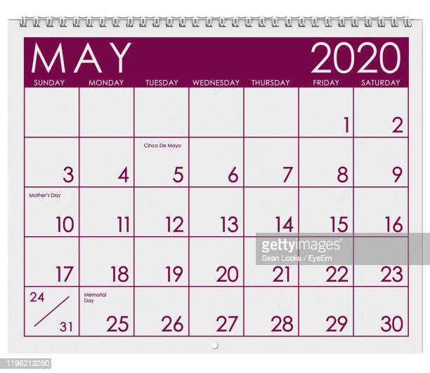 close-up of calendar against white background - mois de mai photos et images de collection