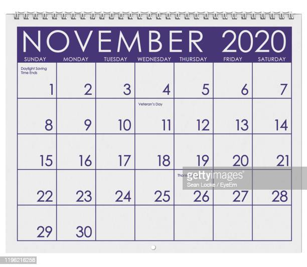 close-up of calendar against white background - november stock pictures, royalty-free photos & images