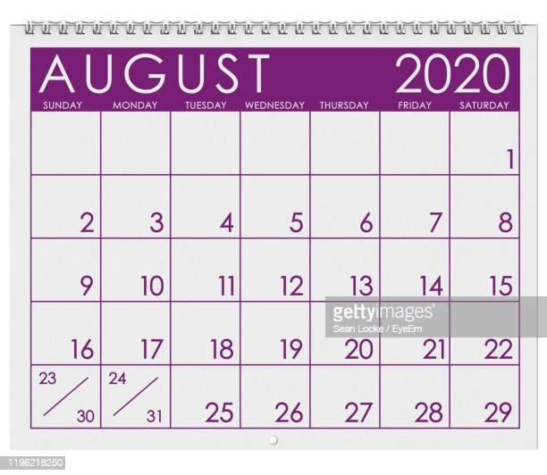 close-up of calendar against white background - august stock pictures, royalty-free photos & images