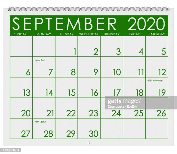 close-up of calendar against white background - september stock-fotos und bilder