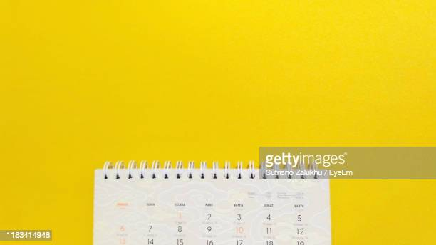 close-up of calendar against yellow background - 2019 calendar background stock pictures, royalty-free photos & images