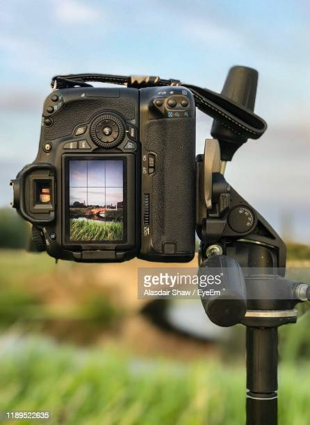 close-up of camera against sky - photographic equipment stock pictures, royalty-free photos & images