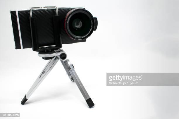 close-up of camera against white background - tripod stock pictures, royalty-free photos & images