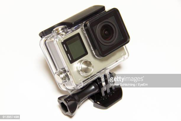 close-up of camera against white background - digital camera stock pictures, royalty-free photos & images