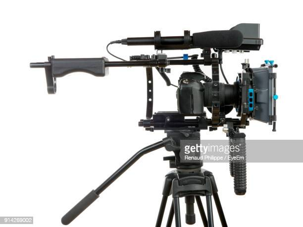 close-up of camera against white background - television camera stock pictures, royalty-free photos & images