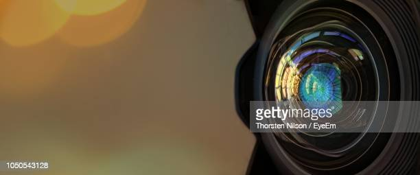 close-up of camera at sunset - lens eye stock photos and pictures