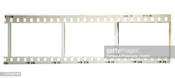 close-up of camera film over white background - color out of space 2019 film stockfoto's en -beelden