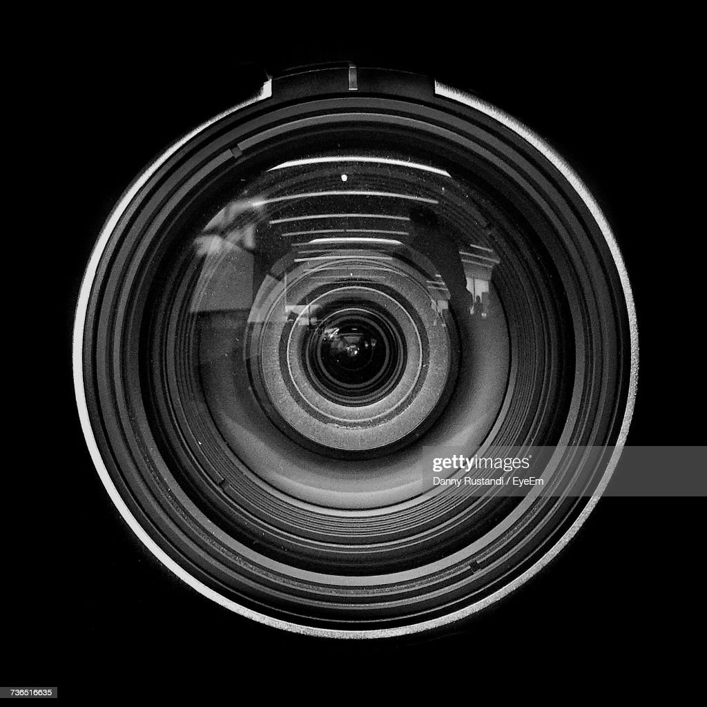 Close-Up Of Camera Lens Against Black Background : Stock Photo