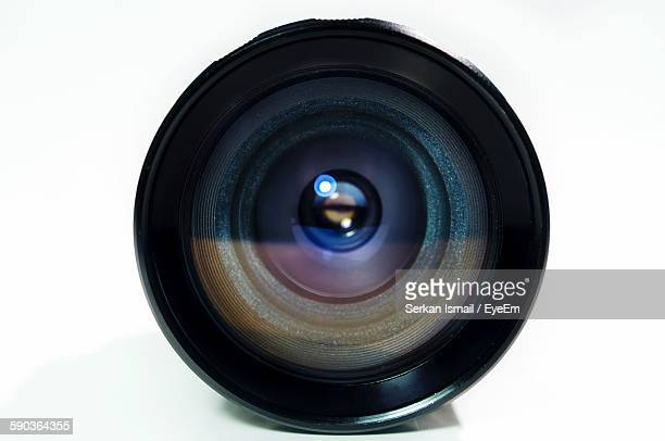 Close-Up Of Camera Lens Against White Background