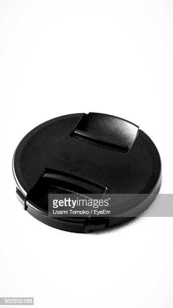 close-up of camera lens lid over white background - lid foto e immagini stock
