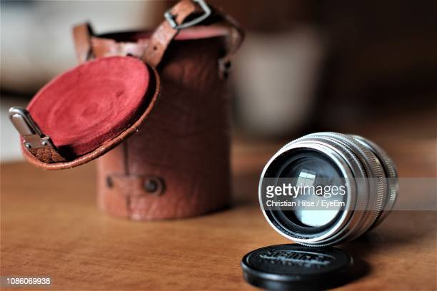 close-up of camera lens on table - christian hilse stock-fotos und bilder