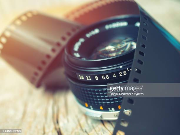close-up of camera lens on table - digital camera stock pictures, royalty-free photos & images