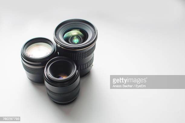 close-up of camera lenses against white background - photographic equipment stock pictures, royalty-free photos & images