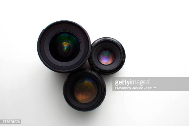 close-up of camera lenses on white background - camera photographic equipment - fotografias e filmes do acervo