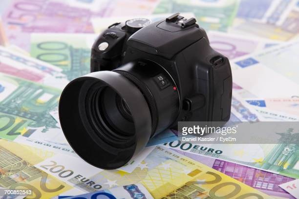 Close-Up Of Camera On Paper Currency