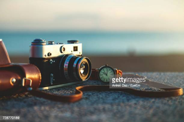 close-up of camera on rock - film camera stock pictures, royalty-free photos & images