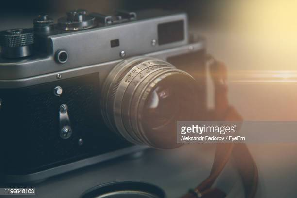 close-up of camera on table - digital camera stock pictures, royalty-free photos & images