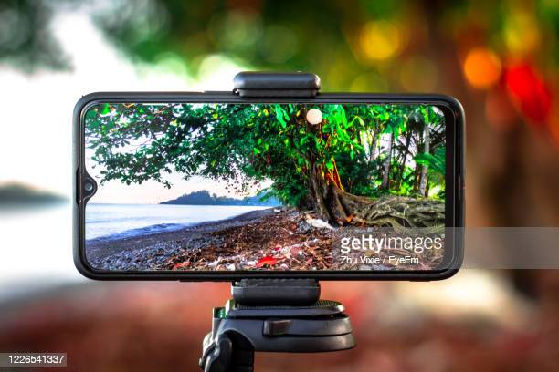 close-up of camera phone in bus - digital viewfinder stock pictures, royalty-free photos & images