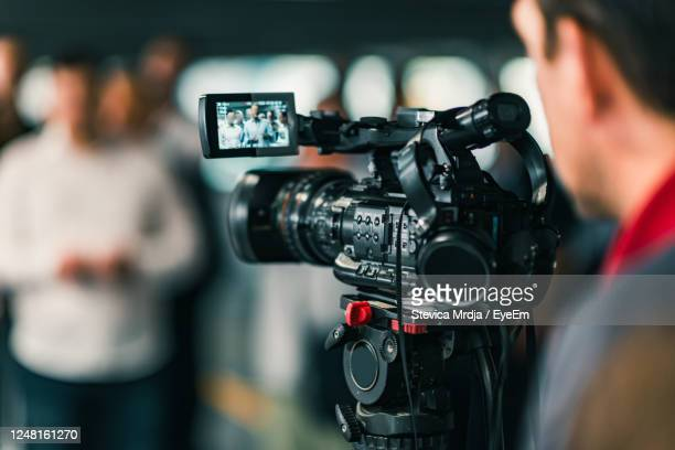 close-up of cameraman filming in studio - film crew stock pictures, royalty-free photos & images