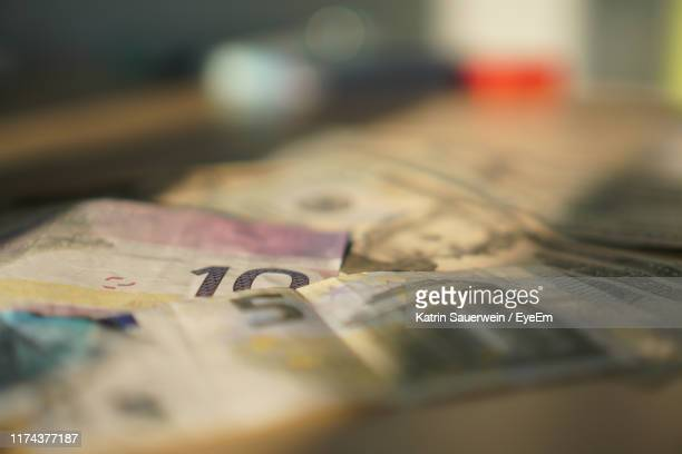 close-up of canadian dollar and euro bill on table - canadian currency stock pictures, royalty-free photos & images