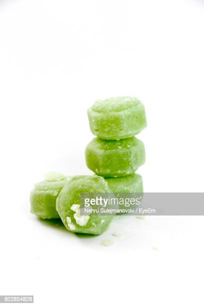 close-up of candies against white background - pile of candy stock photos and pictures