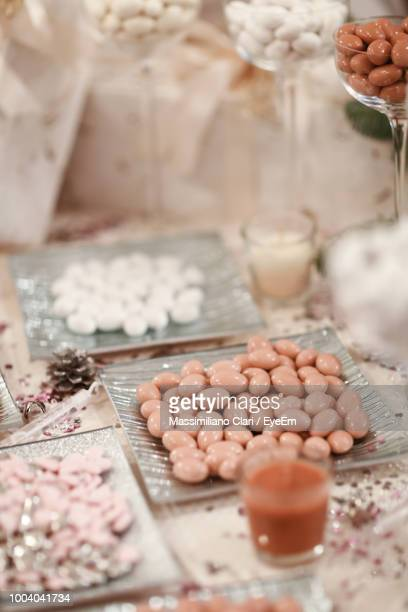 Close-Up Of Candies With Drink On Table