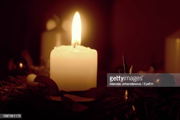 Close-Up Of Candle Burning In Darkroom