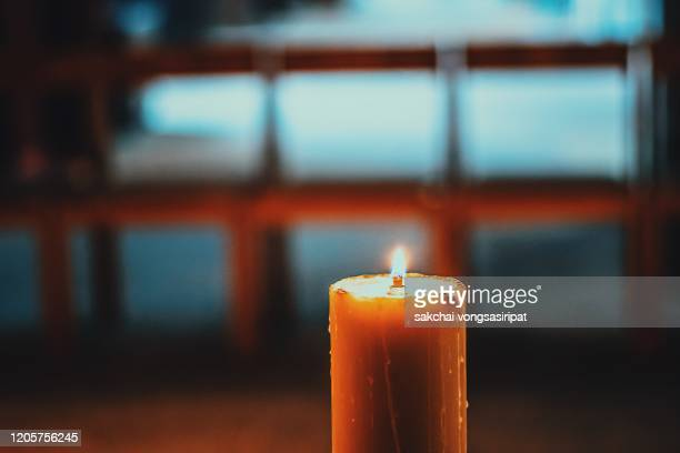 close-up of candle in the church, germany, europe - christianity stock pictures, royalty-free photos & images