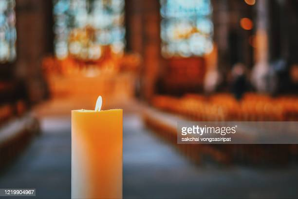 close-up of candle in the church, nuremberg, germany, europe - kirche stock-fotos und bilder