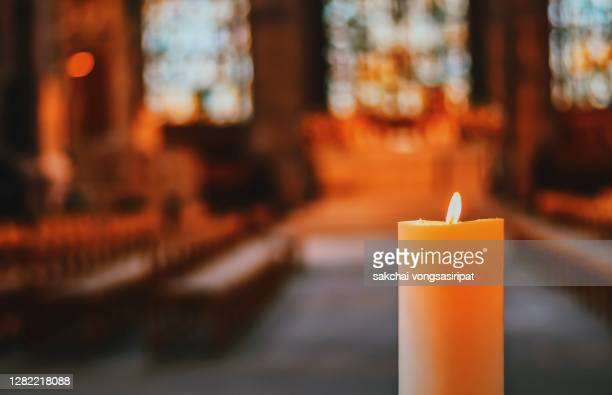 close-up of candle in the church - osterfeuer stock-fotos und bilder