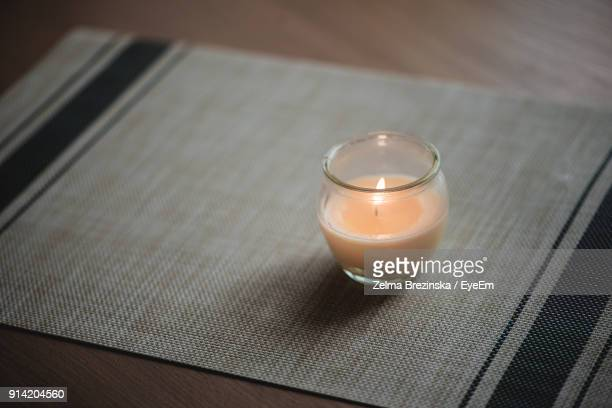 close-up of candle on table - bougie photos et images de collection