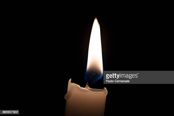 Close-up of candlelight on black background