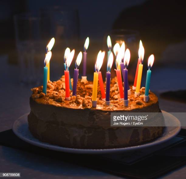 close-up of candles on cake - birthday candles stock photos and pictures