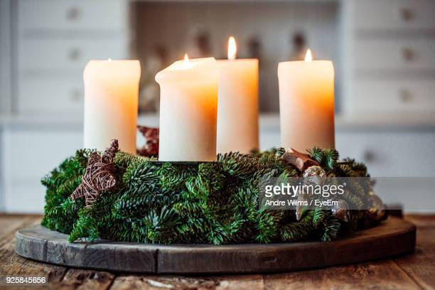 close-up of candles on table during christmas - andre wilms eyeem stock-fotos und bilder