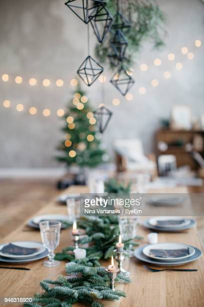 close-up of candles on table - christmas table stock pictures, royalty-free photos & images